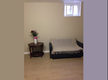 A renovated clean room in a 2-room basement apartment near...