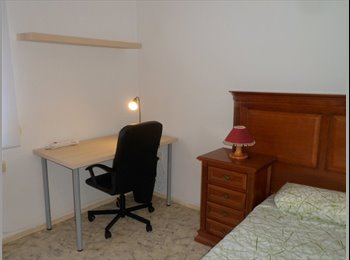Habitación chica estudiante en Alcalá de Henares