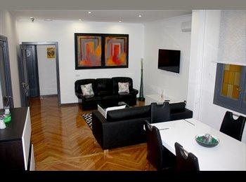 Habitaciones en un lujoso piso en el centro