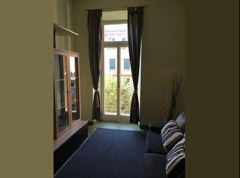 Camera con balcone