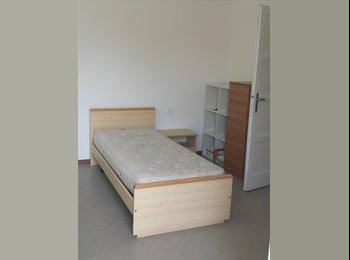 Ampia camera singola con balcone privato
