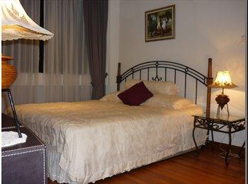 Elegant ensuite bedroom at Orchard