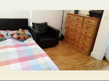 A lage double room fully furnished