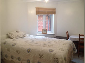 Spacious double room with own bathroom- two mins walk to...