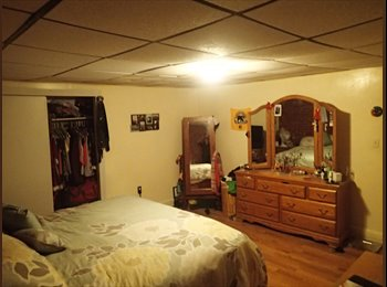 Roommate needed- spacious bedroom in 2 bedroom steps to T!...