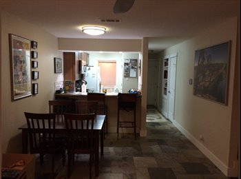 Well appointed SOCO condo with furnished room for rent.