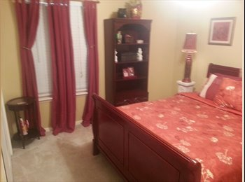 large furnished upstairs bedroom in gated subdivision