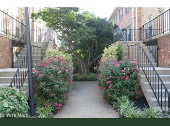 Commuters Dream!  2-story condo w/hw-flooring thoughout and...