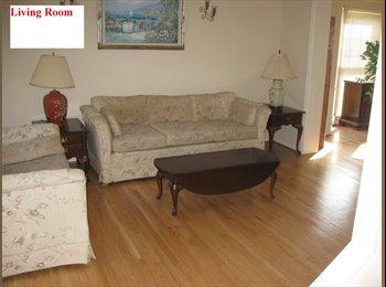 Nice room with hardwood flooring.