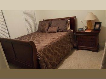 Furnished bedroom including bathroom