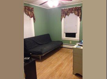 Well-lit corner bedroom
