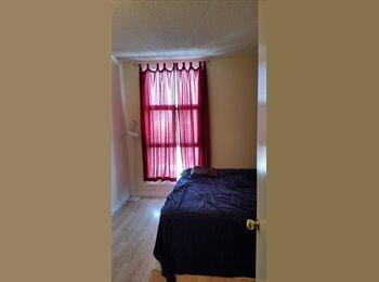 Room in quiet condo for rent.