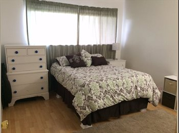 Room for Rent in 2 Bdr Condo with Laid Back Couple