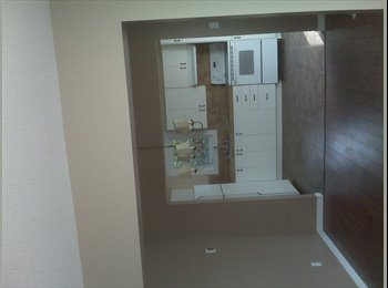 room for rent in large townhouse.